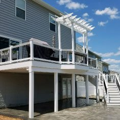 Deck with a patio and an underdeck drainage system