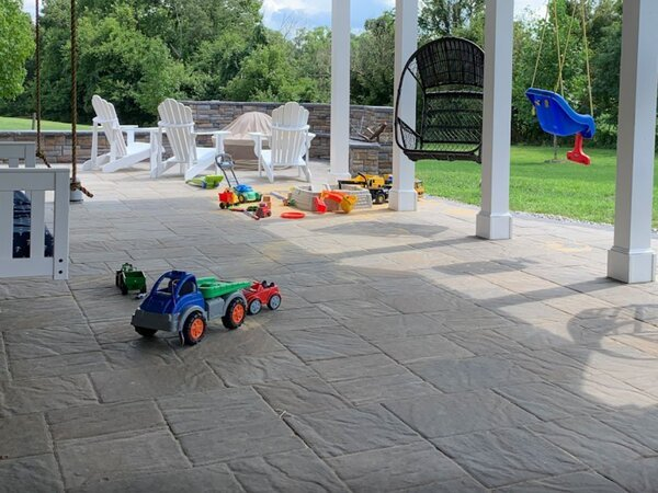Concrete patio with toys and firepit