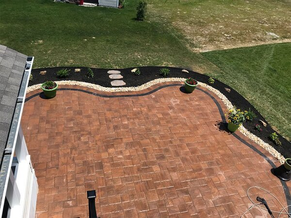 Large paver patio with gravel boundary